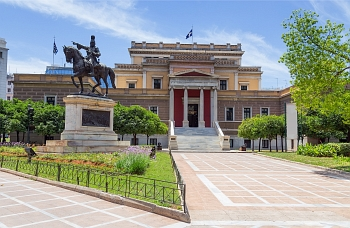 Exterior view of the National Historical Museum (Former Greek Parliament) and statue of Kolokotronis