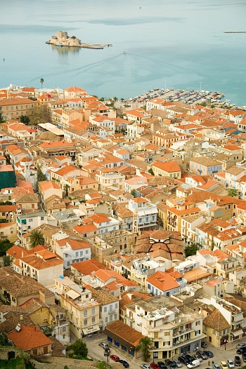 View of picturesque houses and Bourtzi Fort at the city of Nafplion