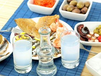 Greek dishes and traditional Greek drink named ouzo
