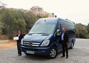 Fantasy VIP Minibus backdropped by Acropolis