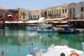 Traditional boats and seaside restaurants in the old Venetian port of Rethymnon Perfecture, Crete island