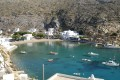 Beautiful bay, white houses, small boats floating on clear blue waters, Sifnos island