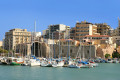 Ships, houses and the Heraklion city port, Crete island