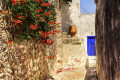 Picturesque flowery stone alley on Hydra island