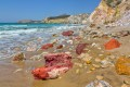 Colorful volcanic rocks and golden sand at exotic Firiplaka beach, Milos island