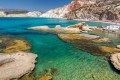 Turquoise waters and beautiful rock formations at the exotic beach of Firiplaka, Milos island