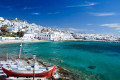 Turqoise Aegean waters and the white washed chora, Mykonos island
