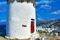 Stone windmill and white houses, Mykonos island