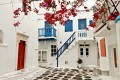 Picturesque white and blue alley with flowers, Mykonos island