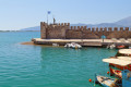 The beautiful fishing village of Nafpaktos and the traditional Greek boats at its port