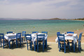 Dining on the beach by the sea, Naxos island
