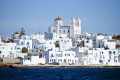 Whitewashed Naoussa village against the vivid blue Aegean sea, Paros island