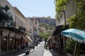 Walking on the beautiful streets of Plaka with a view to Acropolis Hill and the famous Parthenon Temple, Athens