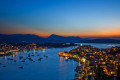 Night-lit Poros island at sunset