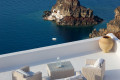 Balcony view to the Aegean sea and a church on the rocks, Santorini island