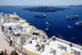 Sugar cubed houses and church domes against the blue Aegean Sea and the caldera, Santorini island