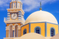 Vivid colors of elaborate church domes in Fira town, Santorini island