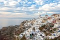 Panoramic view of Oia town at sunset, Santorini island