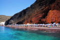 Red beach against the turquoise waters, Santorini island