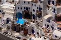 Sugar cubed houses of unique Cycladic architecture with pool, Santorini island