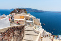 Panoramic view and staircases leading down to the beautiful bay in Fira town, Santorini island