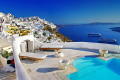 View of the pool, the Aegean sea and the caldera on Santorini island