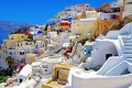 Candy colored houses perched on the volcanic cliffs, Santorini island
