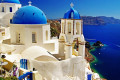 Blue and white church domes, caldera and seaview on Santorini island