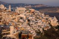 Panoramic view of sugar cubed houses on the volcanic cliff at sunset, Santorini island