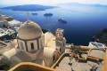 Panoramic view of the caldera, Aegean sea, church domes and ships on Santorini island