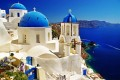 Church domes, sugar cubed houses and the vast blue sea, Santorini island