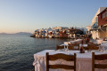 Tavern by the sea on Mykonos island, backdropped by the famous