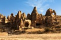 Cappadocia amazing rock formations and horses in Goreme valley, Turkey