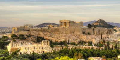 View of Acropolis Hill (middle) with Parthenon Temple, Propylea, Erechtheion, the Theater of Herodes Atticus (foreground) and the Lycabettus Hill (background and right)