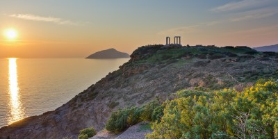 Temple of Poseidon at the edge of Cape Sounion overlooking the Aegean Sea at sunset, Attica region