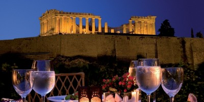 Romantic dinner at the luxurious Divani Palace hotel backdropped by the Parthenon night view, Athens