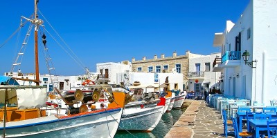 Greek fishing village with traditional colorful boats, Paros island