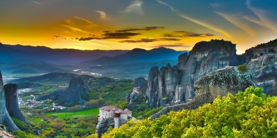 Ageless Meteora monasteries on top of unique rock formations at sunset, Meteora