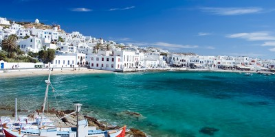 Beautiful bay with turquoise waters encircling the white washed buildings, Mykonos island