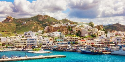 Blue sea and houses at the port, Naxos island