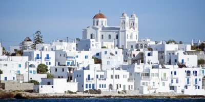 White washed Naoussa Village and the vivid blue Aegean sea, Paros island