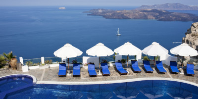 Sunbeds by the pool with amazing sea and caldera view, Santorini island