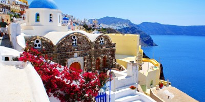 Candy colored houses and the exotic caldera, Santorini island