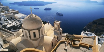 View of church dome and the Aegean Sea encircling the volcanic caldera, Santorini island