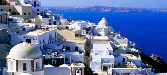 Elevated view of the sugar cubed houses and the vivid blue sea, Santorini island
